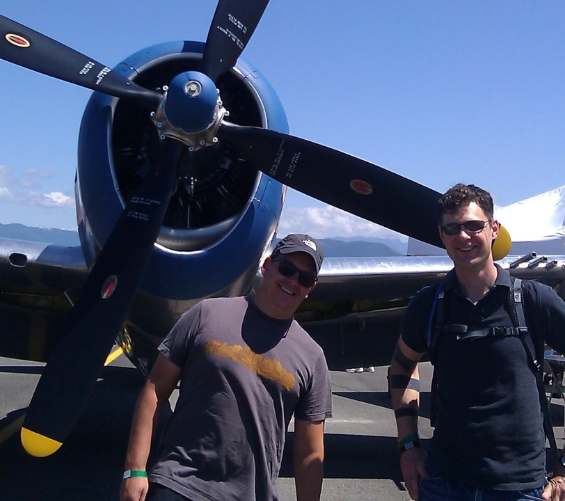 william and chad by a plane