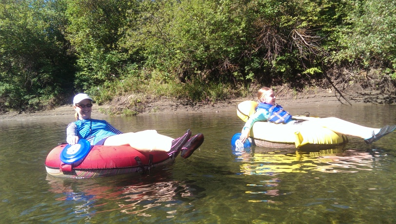Julie and Erin chillin on the Icicle River.