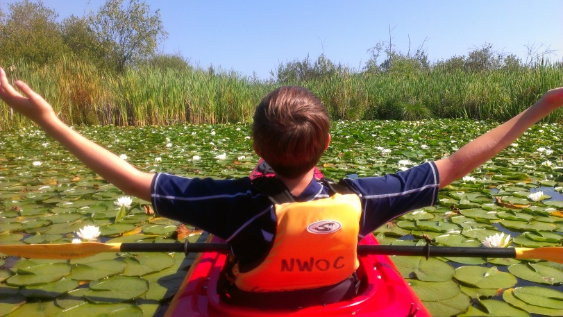 Our nephew, Jack, on a previous trip through the lily pads - the splendour is overwhelming!