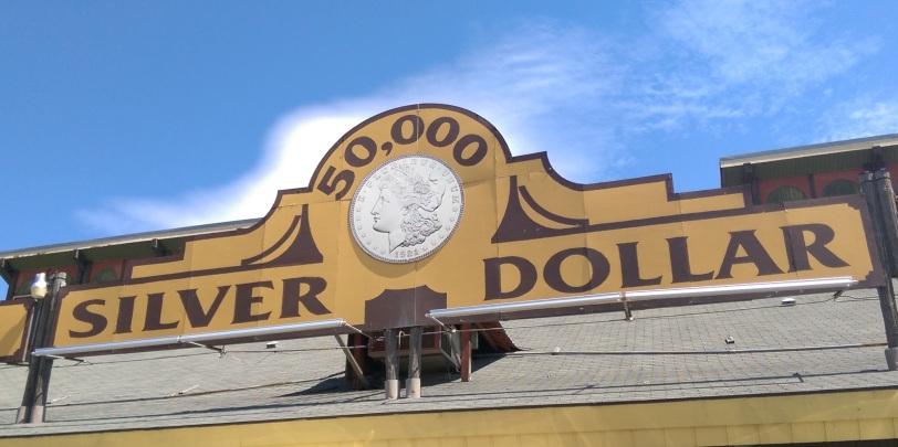 50000 Silver Dollar sign